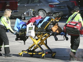 In this Dec. 23, 2019, file photo, paramedics transport a woman suspected of an overdose at the Downtown Mission in Windsor. Witnesses said the woman was treated with Narcan at the scene then transported to hospital.