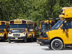 School buses are parked in a lot off Hudson Avenue in West Windsor, Tuesday, August 18, 2020.