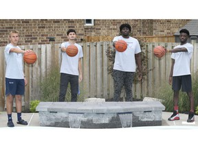 TECUMSEH, ON. SEPTEMBER 9, 2020 -  University of Windsor basketball recruits, from left, Brayden Amlin, Ben Mascarenhas, Segun Akin-Akinbulumo and Isaiah Mayambu are shown on Wednesday, September 9, 2020 in Tecumseh, ON. (DAN JANISSE - The Windsor Star)