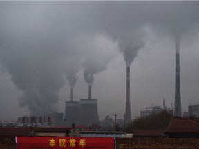 This file photo taken on November 19, 2015 shows smoke belching from a coal-fueled power station near Datong, in China's northern Shanxi province. China's surprise pledge to slash its carbon footprint to zero by 2060 was met with cautious applause, but fresh spending on coal to rev up a virus-hit economy threatens to nullify its audacious bid to lead the world into a low carbon future.