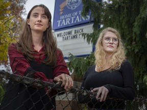 "Former Walkerville Collegiate students, Alice Snaden, left, and Abrial Cooke, are pictured outside their former high school, Wednesday, Oct. 14, 2020.  The two women have launched The Power Project, whose aim is seeing changes implemented at the board and school levels ""to ensure that students have a safe and accessible reporting process for abuse,"" according to Cooke."