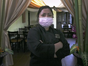 Renu Anderson, owner of Thai Palace restaurant is shown at the east Windsor business on Wednesday, October 14, 2020. A lawyer is claiming discrimination and threatening to sue the restaurant, with a demand of $20,000 to make the litigation go away, after Anderson insisted he wear a mask to pick up food at the restaurant's outdoor takeout window.