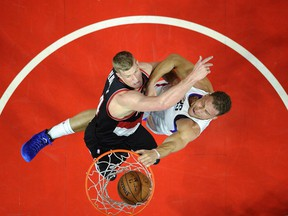 Blake Griffin of the Los Angeles Clippers slam dunks against Mason Plumlee of the Portland Trail Blazers during the first half in Game One of the Western Conference Quarterfinals during the 2016 NBA Playoffs at Staples Center April 17, 2016, in Los Angeles, California.