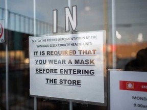 A sign at the entrance of the Home Hardware store on Seminole Street in Windsor notifies customers of indoor masking requirements. Photographed Nov. 20, 2020.