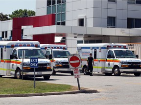 During the first wave of the novel coronavirus, Essex-Windsor EMS ambulances are shown lined up outside Erie Shores HealthCare in Leamington on July 2, 2020.