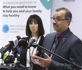 Dr. Wajid Ahmed speaks at a news conference in March 2020 while CEO Theresa Marentette looks on.