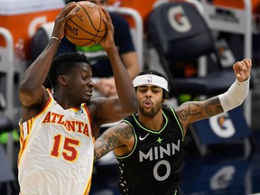 Clint Capela of the Atlanta Hawks catches a pass intended for D'Angelo Russell of the Minnesota Timberwolves during the second quarter of the game at Target Center on January 22, 2021 in Minneapolis, Minnesota.