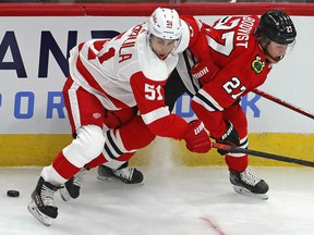 Valtteri Filppula of the Detroit Red Wings is called for holding Adam Boqvist of the Chicago Blackhawks at the United Center on January 22, 2021 in Chicago, Illinois.