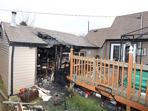 Windsor, Ontario. January 15, 2021. Damage to a garage and deck on the 1700 block of South Cameron Friday. (NICK BRANCACCIO/Windsor Star)