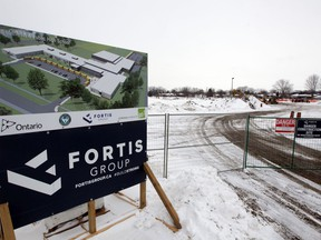 Construction is shown underway on Feb. 18, 2021, near the intersection of Victoria Street South and Simcoe Street in Amherstburg, where a new public high school is being built. A grassroots effort is underway to preserve part of the remaining park.