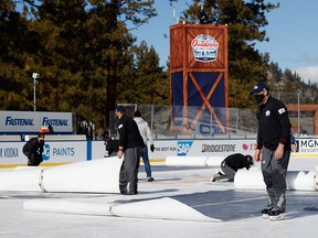 NHL workers cover the ice following the first period between the Vegas Golden Knights and the Colorado Avalanche at Lake Tahoe at the Edgewood Tahoe Resort on February 20, 2021 in Stateline, Nevada.