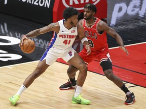 Chicago Bulls forward Patrick Williams defends against Detroit Pistons forward Saddiq Bey during the first half of an NBA game at United Center.