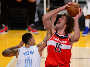 Washington Wizards center Robin Lopez moves to the basket against Los Angeles Lakers forward Kyle Kuzma during the second half at Staples Center.