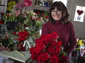 TECUMSEH, ONT:. FEBRUARY 12, 2021 - Kathy McCarthy, owner of Country Flower Shoppe, prepares flower Valentine's Day bouquets, Friday, Feb. 12, 2021.