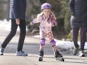 Margot McLinden-Byrne, 5, enjoys the spring-like weather on Wednesday, February 24, 2021 at Windsor's Jackson Park. She was accompanied by Wanda and Leah McLinden.