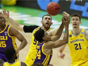 Indianapolis, Indiana, USA; Louisiana State Tigers guard Cameron Thomas (24) and Michigan Wolverines forward Austin Davis (51) battle for a rebound during the second half in the second round of the 2021 NCAA Tournament at Lucas Oil Stadium. Mandatory Credit: Joshua Bickel-USA TODAY Sports