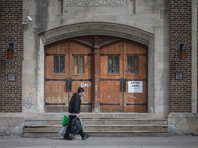 A man carries his belongings outside the Downtown Mission of Windsor location at 664 Ouellette Ave. on March 25, 2021.