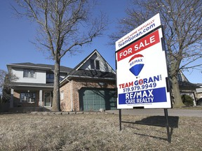 Local real estate prices are surging and available homes aren't on the market very long before being snapped up. Here, a For Sale is shown in front of a home in the 13000 block of St Gregory's Road in Tecumseh on Monday, March 1, 2021.