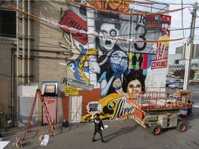 Windsor is offering grants to artists to be creative in the city. Daniel Bombardier a.k.a DENIAL is shown Oct. 29, 2019, working on a large mural for the Windsor International Film Festival in what became WIFF Alley across the street from the Capitol Theatre.