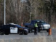 A police officer stops a motorist at a police checkpoint at the Manitoba-Ontario provincial boundary.