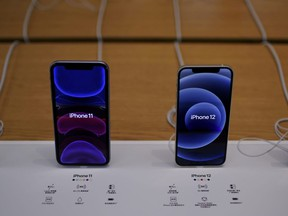 Apple's 5G iPhone 12 and iPhone 11 are seen at an Apple Store in Shanghai, China, Oct. 23, 2020.