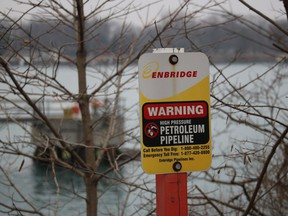A sign marks where an Enbridge pipeline lands in St. Clair Township after crossing the St. Clair River.