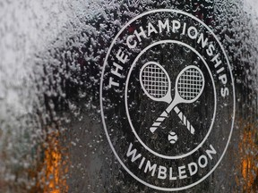 In this file photo a water feature with the Wimbledon logo stands by the members area at the All England Tennis Club in Wimbledon, southwest London, on July 1, 2018, on the eve of the 2018 Wimbledon Championships tennis tournament.