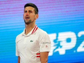 Serbias Novak Djokovic reacts during his ATP 250 Serbia Open semi-final singles tennis match against Russia's Aslan Karatsev at The Novak Tennis Centre in Belgrade on April 24, 2021.