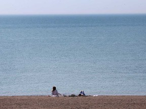 People take advantage of warm weather on April 6, 2021, to enjoy Colchester Beach in the Town of Essex.