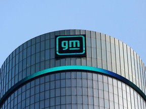 FILE PHOTO: The new GM logo is seen on the facade of the General Motors headquarters in Detroit, Michigan, U.S., March 16, 2021. Picture taken March 16, 2021.