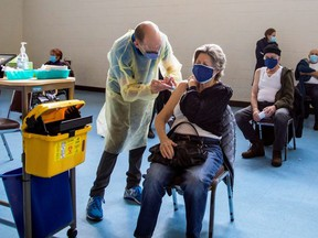 A nurse from Humber River Hospital administers the Pfizer/BioNTech COVID-19 vaccine at St Fidelis Parish in Toronto, March 17, 2021.