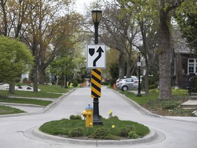 A historic streetlight is shown in the 200 block of Prado Place in Riverside on Tuesday, April 20, 2021.