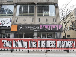 """The local chamber of commerce is warning things could get tougher for small business. Shown here on Friday, April 16, 2021, a downtown Windsor business's message to the government: """"Stop holding this Business Hostage!"""""""