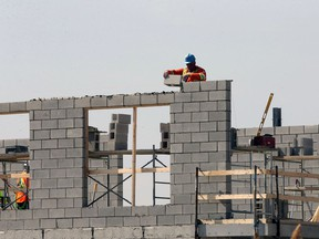Demand for housing is increasing in Windsor, leading to more neighbourhood disputes over what's appropriate. In this March 17, 2021 file photo, construction workers and masons were busy preparing roadways and laying concrete block on portions of a new east Windsor commercial and residential development.