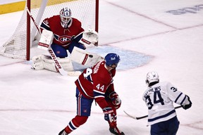 Montreal Canadiens goaltender Jake Allen makes a save against Maple Leafs' Auston Matthews as defenceman Joel Edmundson defends during the second period at Bell Centre on Monday, May 3, 2021.