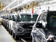 FILE PHOTO: 2020 Ford Explorer cars are seen at Ford's Chicago Assembly Plant in Chicago, Illinois, U.S. June 24, 2019.