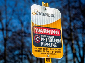 A signpost marks the presence of Enbridge's Line 5 pipeline, which Michigan Governor Gretchen Whitmer ordered shut down by May 12.