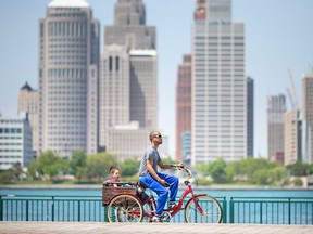 Windsor resident Reggie Jones gives his two-year-old daughter Lucie a ride on Windsor's riverfront on May 18, 2021.