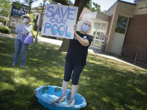 Susan Gold Smith stands participates in a rally with approximately 30 other people to prevent the closing of Adie Knox, on Thursday, June 17, 2021.