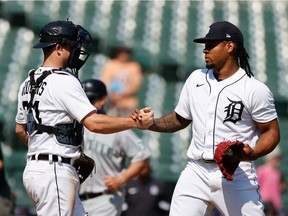 Detroit Tigers catcher Jake Rogers (34) and starting pitcher Gregory Soto (65) celebrate after defeating the Seattle Mariners at Comerica Park.