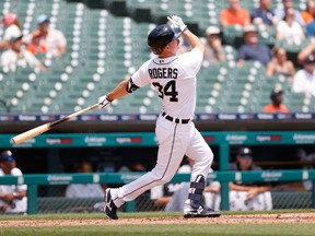 Jun 10, 2021; Detroit, Michigan, USA;  Detroit Tigers catcher Jake Rogers (34) hits a home run in the second inning against the Seattle Mariners at Comerica Park. Mandatory Credit: Rick Osentoski-USA TODAY Sports