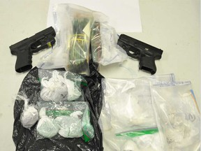 Two illegal handguns and quantities of fentanyl and cocaine seized by Windsor police on June 11, 2021.