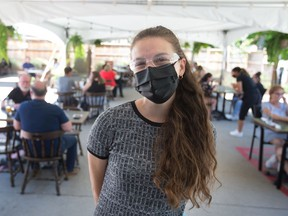 """""""We have amazing guests."""" Nicole Thompson, manager of the Thompson House, stands beneath the Windsor restaurant's packed covered patio on the first day of in-person dining under Step 1 of the province's reopening plan, Friday, June 11, 2021."""