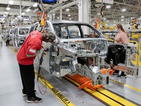 Stellantis assembly workers work on assembling the 2021 Jeep Grand Cherokee L at the Detroit Assembly Complex - Mack Plant in Detroit, Michigan, U.S., June 10, 2021. Picture taken June 10, 2021.