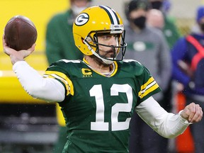 Aaron Rodgers of the Green Bay Packers throws a pass in the first half against the Los Angeles Rams at Lambeau Field on January 16, 2021 in Green Bay, Wisconsin.
