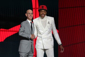 Scottie Barnes (Florida State) poses with NBA commissioner Adam Silver after being selected as the number four overall pick by the Toronto Raptors on Thursday.