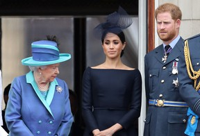 Queen Elizabeth II, Prince Harry, Duke of Sussex and Meghan, Duchess of Sussex on the balcony of Buckingham Palace as the Royal family attend events to mark the Centenary of the RAF on July 10, 2018 in London, England.