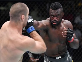 In this handout image provided by UFC, (R-L) Uriah Hall of Jamaica punches Sean Strickland in a middleweight fight during the UFC Fight Night event at UFC APEX on July 31, 2021 in Las Vegas, Nevada.