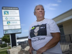 Karen Peter, whose son Bryce Peter committed suicide on Father's Day in 2017, is pictured outside the Canadian Mental Health Association after a news conference announcing details for Suicide Awareness Month in September, on Wednesday, August 25, 2021.