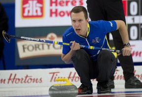 Alberta skip Brendan Bottcher sits in the rings during the finals of the Tim Hortons Brier March 14, 2021 at WinSport Arena in Calgary.